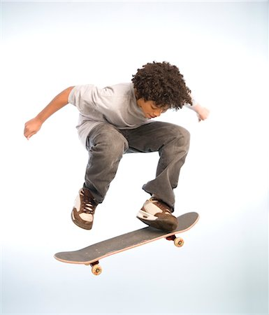 Skateboarder Doing an Ollie Stock Photo - Premium Royalty-Free, Code: 600-02757072