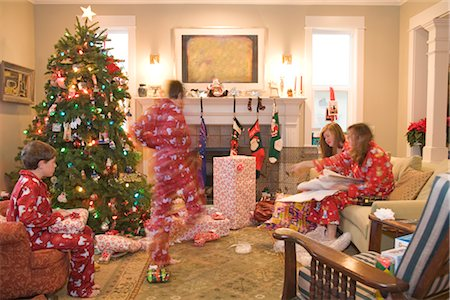 pantyhose kid - Family Opening Presents on Christmas Morning Stock Photo - Premium Royalty-Free, Code: 600-02757085