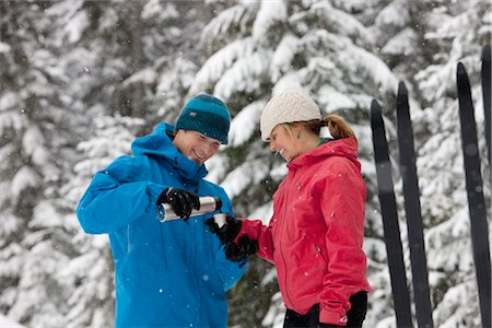 Close-up of Couple Drinking from Thermos, Cross Country Skiing, Whistler, British Columbia, Canada Stock Photo - Premium Royalty-Free, Code: 600-02757260