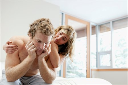 Woman Comforting Man Sitting on Edge of Bed Stock Photo - Premium Royalty-Free, Code: 600-02757311