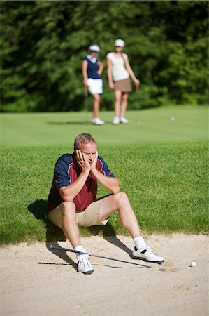 Man Sitting by Sand Trap on Golf Course Stock Photo - Premium Royalty-Free, Code: 600-02751484