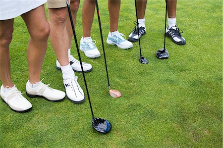 Close-up of Golfers' Feet Stock Photo - Premium Royalty-Free, Code: 600-02751522