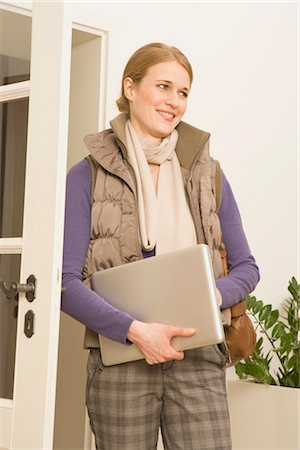 Woman Holding Laptop Stock Photo - Premium Royalty-Free, Code: 600-02786735