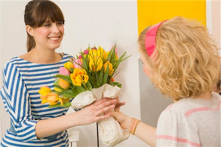 flower greeting - Woman Receiving Flowers Stock Photo - Premium Royalty-Free, Code: 600-02786739