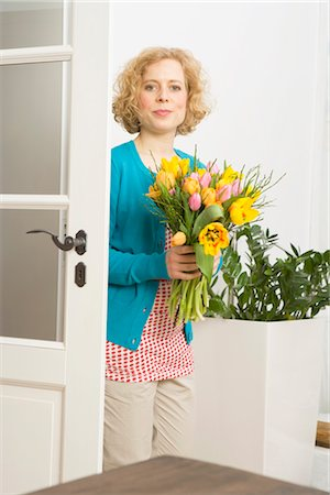 flower greeting - Woman Holding Flowers Stock Photo - Premium Royalty-Free, Code: 600-02786731