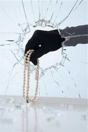 Hand Stealing Pearl Necklace Stock Photo - Premium Royalty-Free, Code: 600-02801119