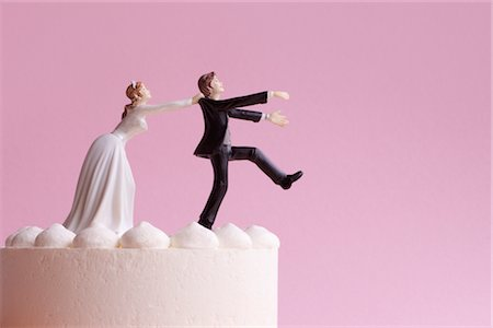 running away scared - Wedding Cake Figurines, Bride Grabbing Runaway Groom Stock Photo - Premium Royalty-Free, Code: 600-02801225