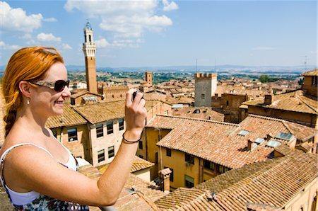 Woman Taking Photograph, Siena, Siena Province, Tuscany, Italy Stock Photo - Premium Royalty-Free, Code: 600-02828596