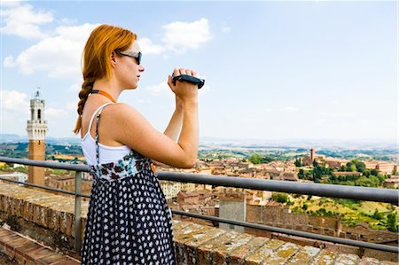 Woman Shooting Video, Siena, Siena Province, Tuscany, Italy Stock Photo - Premium Royalty-Free, Code: 600-02828599