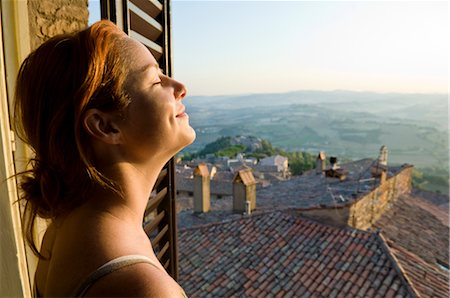 Woman at Window, Todi, Province of Perugia, Umbria, Italy Stock Photo - Premium Royalty-Free, Code: 600-02828601