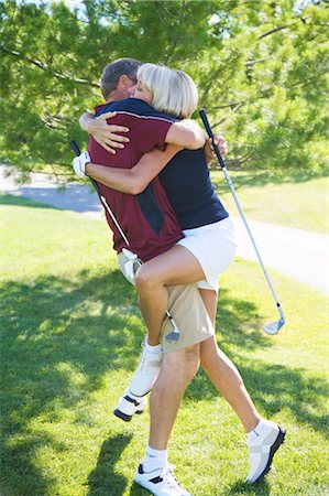Couple Making Out on Golf Course Stock Photo - Premium Royalty-Free, Code: 600-02833097