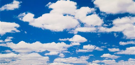 fluffy - White Clouds in Blue Sky Stock Photo - Premium Royalty-Free, Code: 600-02886359