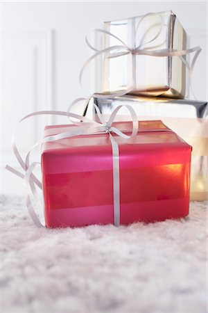 present wrapped close up - Gifts Stock Photo - Premium Royalty-Free, Code: 600-02887530