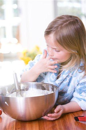 preteen girl licking - Little Girl Baking Stock Photo - Premium Royalty-Free, Code: 600-02883064