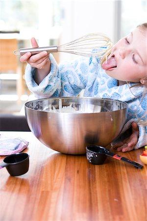 preteen girl licking - Little Girl Baking, Eating the Batter Stock Photo - Premium Royalty-Free, Code: 600-02883069