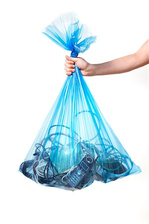 Person Holding Blue Recycling Bag Full of Electronics Stock Photo - Premium Royalty-Free, Code: 600-02883251