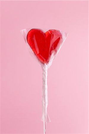 picture of a red lollipop - Heart-shaped Lollipop Stock Photo - Premium Royalty-Free, Code: 600-02903809