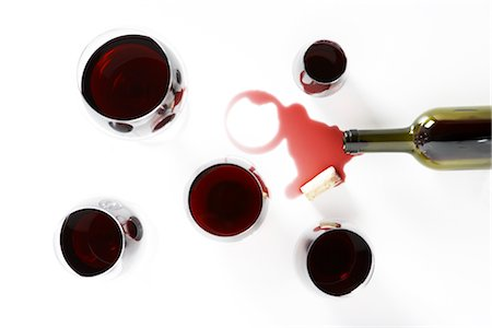 Glasses of Red Wine with Spilled Bottle Stock Photo - Premium Royalty-Free, Code: 600-02912202