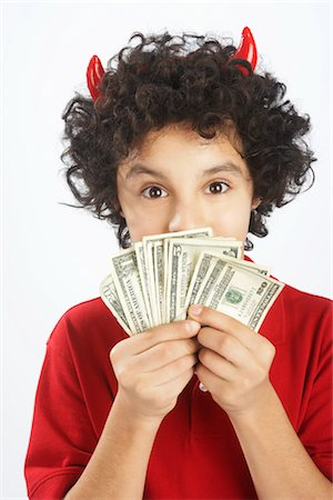 Little Boy Dressed as Devil Holding Cash Stock Photo - Premium Royalty-Free, Code: 600-02912786