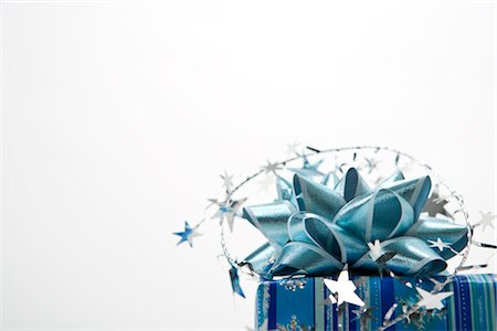 stars on white background - Wrapped Gift Stock Photo - Premium Royalty-Free, Code: 600-02972927
