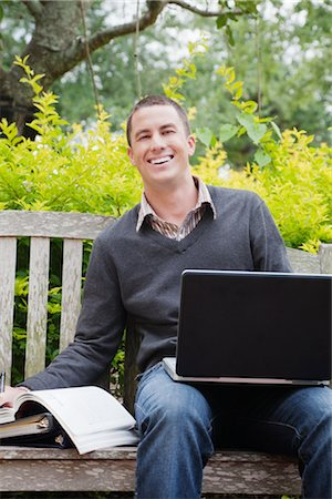University Student Sitting on a Bench Using a Laptop Computer Stock Photo - Premium Royalty-Free, Code: 600-02973170