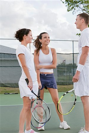 Group of People Playing Tennis Stock Photo - Premium Royalty-Free, Code: 600-02973182