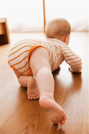 Baby Crawling on Floor Stock Photo - Premium Royalty-Free, Code: 600-03004406