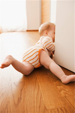 Baby Crawling on Floor Stock Photo - Premium Royalty-Free, Code: 600-03004407