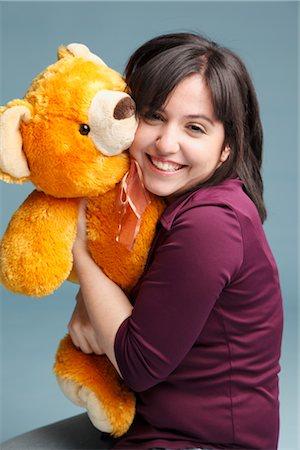 Woman Hugging a Teddy Bear Stock Photo - Premium Royalty-Free, Code: 600-03004437
