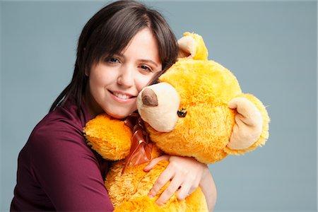 Woman Hugging a Teddy Bear Stock Photo - Premium Royalty-Free, Code: 600-03004438