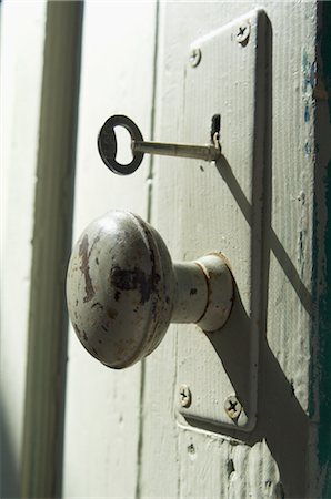 Close-Up of Old Doorknob and Key Stock Photo - Premium Royalty-Free, Code: 600-03003919
