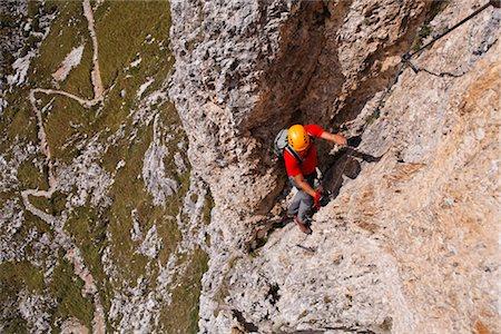 Man Climbing Brigata Tridentina Via Ferrata, Sella Massif, Dolomites, Italy Stock Photo - Premium Royalty-Free, Code: 600-03014915