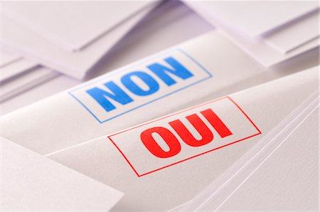 Non and Oui Written on Paper Stock Photo - Premium Royalty-Free, Code: 600-03054010