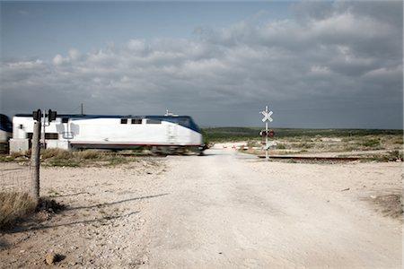 Railroad Crossing, Amistad National Recreation Area, Texas, USA Stock Photo - Premium Royalty-Free, Code: 600-03054123