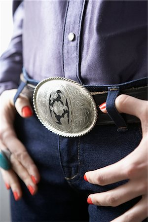 Close-Up of Western Belt Buckle Stock Photo - Premium Royalty-Free, Code: 600-03053865