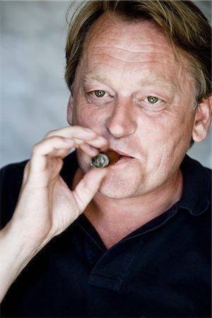 Man Smoking Cigar Stock Photo - Premium Royalty-Free, Code: 600-03053977
