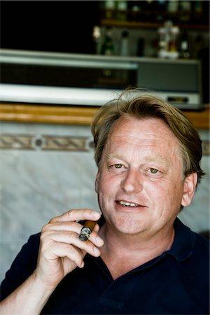 Man with Cigar Stock Photo - Premium Royalty-Free, Code: 600-03053978