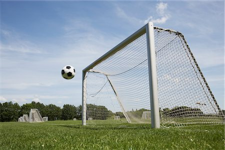 Soccer Ball and Net Stock Photo - Premium Royalty-Free, Code: 600-03069341