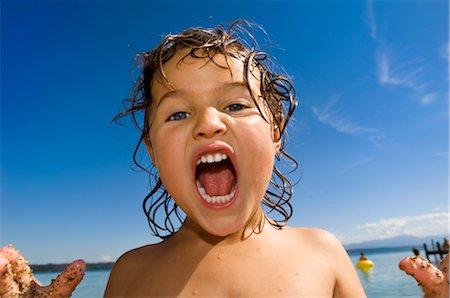 Close-up of Girl Yelling Stock Photo - Premium Royalty-Free, Code: 600-03152215