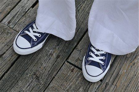 Woman Wearing Sneakers Stock Photo - Premium Royalty-Free, Code: 600-03152220