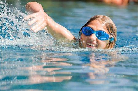 Girl Swimming Stock Photo - Premium Royalty-Free, Code: 600-03152341