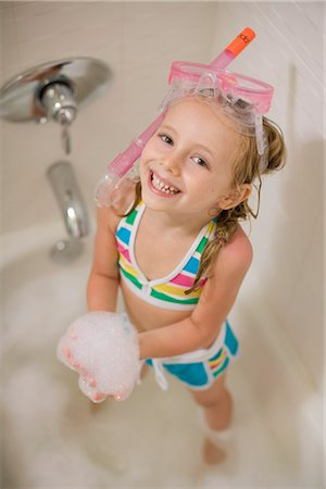 Girl with Snorkel in Bathtub Stock Photo - Premium Royalty-Free, Code: 600-03152946
