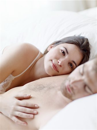 people having sex - Couple Cuddling in Bed Stock Photo - Premium Royalty-Free, Code: 600-03178975
