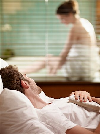 Man Lying in Bed Watching Woman Getting Ready to Take a Bath Stock Photo - Premium Royalty-Free, Code: 600-03178979