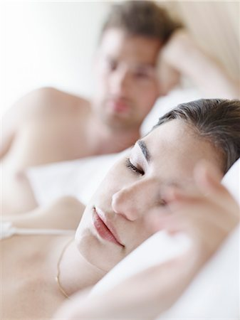 Couple in Bed, Man Looking at Sleeping Woman Stock Photo - Premium Royalty-Free, Code: 600-03178973