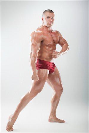 Portrait of Body Builder Stock Photo - Premium Royalty-Free, Code: 600-03179207