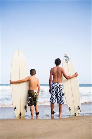 Boys Holding Surfboards Stock Photo - Premium Royalty-Free, Code: 600-03171577