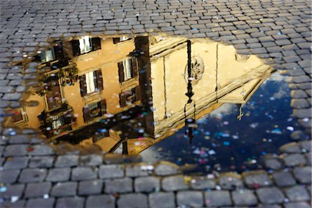 Confetti and Reflection of Building in Puddle, Piazza Navona, Rome, Italy Stock Photo - Premium Royalty-Free, Code: 600-03171635