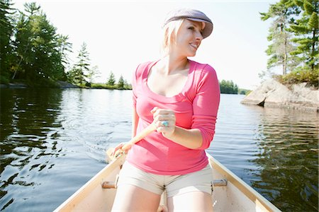 Woman Canoeing on Kahshe Lake, Muskoka, Ontario, Canada Stock Photo - Premium Royalty-Free, Code: 600-03195044