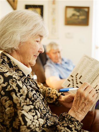 Elderly Couple in Retirement Home, Woman Working on Crossword Puzzle Stock Photo - Premium Royalty-Free, Code: 600-03210387